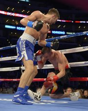 Nathan Cleverly, left, of Wales knocks down Shawn Hawk during the seventh round of their WBO light heavyweight title bout, Saturday, Nov. 10, 2012, in Los Angeles. Cleverly won in an eighth round TKO.