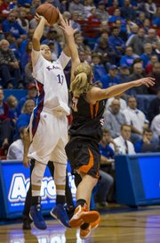 Kansas guard Monica Engelman (13) fires up a shot over the outstretched arm of Kara Jenkins during Kansas' game against Idaho State, Sunday, Nov. 11, 2012 at Allen Fieldhouse.