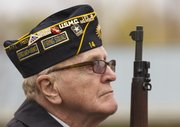 Veteran John McCoin, Lawrence, listens as Taps is played during a Veterans Day ceremony at American Legion Dorsey-Liberty Post 14 on Sunday. The ceremony was a joint event by the American Legion, Disabled American Veterans and Veterans of Foreign Wars.