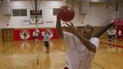 Lawrence High senior Derrick Williams goes in for a layup during the first day of basketball practice on Monday, Nov. 12, 2012, at LHS.