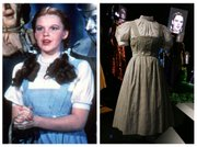 "This photo combo shows, at left, actress Judy Garland as Dorothy in a scene from ""The Wizard of Oz,"" and at right, is an Oct. 16, 2012, file photo showing the dress Garland wore in the movie, on display in London. On Sunday, Nov. 11, 2012, auction house Julien&squot;s Auctions said the gingham dress fetched the highest price of any item during a two-day auction of Hollywood memorabilia that attracted bids from around the world, selling for $480,000."