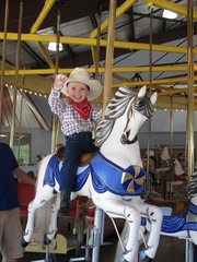 A young cowboy enjoys a ride on the 1913 Parker Carousel at the C.W. Parker Carousel Museum in Leavenworth.