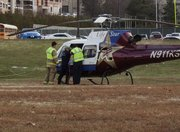 Medics load an injured cyclist onto an air ambulance in Memorial Stadium's parking lot. The cyclist was injured when he was struck by an SUV at the intersection of 11th and Kentucky streets on Tuesday, Nov. 13, 2012.