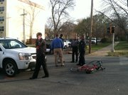 Lawrence police investigate a vehicle-versus-bicycle accident at 11th and Kentucky streets. The cyclist suffered critical injuries and was flown by air ambulance to a Kansas City-area hospital.