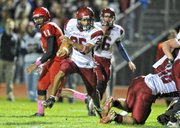 Eudora High senior Markis Hill (25) breaks off a long run against Ottawa. Hill and three backfield-mates have combined for 3,173 rushing yards and 34 touchdowns for the Cardinals (11-1).