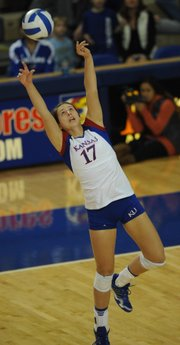KU junior Erin McNorton (17) sets a ball against Oklahoma on Wednesday, Nov. 14, 2012, at Horejsi Center.