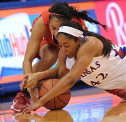 Kansas' CeCe Harper (42) takes control of a possession against Jordan Hunter (34) of Southeast Missouri State on Wednesday, Nov. 14, 2012, at Allen Fieldhouse.