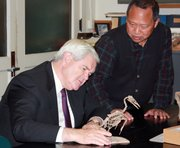 Former U.S. House Speaker Newt Gingrich examines an ichthyornis skeleton along with vertebrate paleontology collections manager Desui Miao at the KU Natural History Museum on Wednesday.