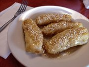 Honey Fried Banana Topped with Roasted Sesame Seeds, one of the desserts at Little Saigon Caf, 1524B W. 23rd St.