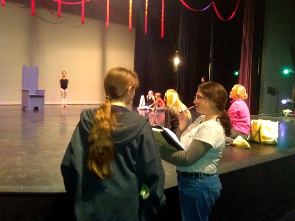 "Jenifer Harmon, foreground, right, discusses technical cues with apprentice stage manager Caelon Rogers for the Arts Center's upcoming production of ""The Red Ribbon."""