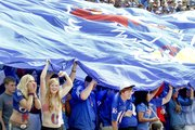 Kansas University students and fans unveil a large KU banner and cheer on the Jayhawks before the start of the football game against TCU on Sept. 15 at Memorial Stadium. KU has no plans to begin selling alcohol at its games, unlike new Big 12 addition West Virginia University.