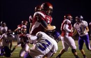 Eudora&#39;s Gabe Cleveland (7) plows through Dalton Hays (3) and into the end zone for a score during Eudora&#39;s game against Piper in the Kansas Class 4A Sub-state championship, Friday, Nov. 16, 2012 in Eudora.
