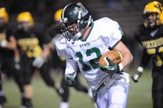 Free State running back Joe Dineen breaks free on a first-half run against Shawnee Mission West on Friday at Shawnee Mission South District Stadium.