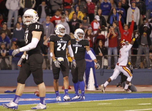 Kansas defenders Ben Heeney, left, Bradley McDouglad (24) and Lubbock Smith walk away as Iowa State receiver Aaron Horne celebrates a touchdown during the second quarter, Saturday, Nov. 17, 2012 at Memorial Stadium.