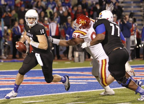 Kansas quarterback Dayne Crist narrowly avoids getting snagged by Iowa State defensivel lineman Jake McDonough, who is pushed away by KU lineman Aslam Sterling during the second quarter on Saturday, Nov. 17, 2012 at Memorial Stadium.