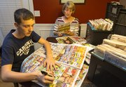 "Armed with a black Sharpie marker, 15-year-old Broderick Topil and his mother Becky scan through pages of newspaper inserts looking for coupons at their Eudora residence Monday evening. The pair, who spend about 10 hours per week cutting coupons, will be featured on TLC's ""Extreme Couponing""  show Tuesday evening."