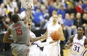 Kansas guard Ben McLemore hangs for a shot as he is fouled by Washington State forward Richard Longrus during the first half of the CBE Classic, Monday, Nov. 19, 2012 at the Sprint Center in Kansas City, Missouri.