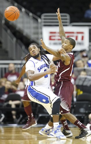 Saint Louis guard Jordair Jett and Texas A&M guard Fabyon Harris go for a loose ball during the first half of the CBE Classic, Monday, Nov. 19, 2012 at the Sprint Center in Kansas City, Missouri.