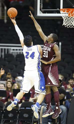 Texas A&M forward Elston Turner defends against a shot from Saint Louis forward Cody Ellis during the first half of the CBE Classic, Monday, Nov. 19, 2012 at the Sprint Center in Kansas City, Missouri.