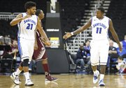 Saint Louis players Dwayne Evans, left, and Mike McCall Jr. slap hands during a run by the Billikens in the second half of the CBE Classic, Monday, Nov. 19, 2012, at the Sprint Center in Kansas City, Mo.