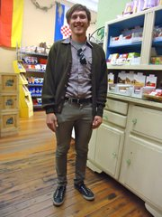 Jason Koontz, Lawrence. Clothing details: Cardigan, thrifted, 5 years ago, $13; shirt, thrifted in California, March, $3; pants, Buffalo Exchange, May, $11; shoes, Ross, Converse All-Star, August, $20.