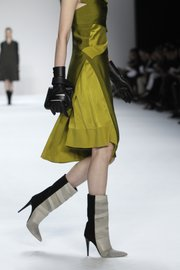 Spice up winter outfits by wearing skirts and dresses with boots, like these from the Narciso Rodriguez Fall 2012 collection modeled during Fashion Week in New York on Feb. 14, 2012.
