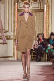 Look for a well-fitted winter coat, like this one from the Thakoon Fall 2012 collection, modeled during Fashion Week in New York on Feb. 12, 2012.