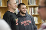 Lawrence High&#39;s Shane Willoughby, right, and LHS baseball coach Brad Stoll visit before Willoughby signed a letter of intent to play baseball with Youngstown State, Tuesday, Nov. 20, 2012, at LHS.