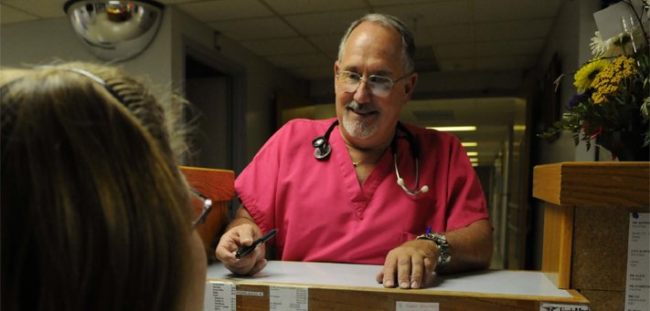 Dr. M. Ray Kenoyer talks with one of the nurses at the Hamilton County Hospital in Syracuse. Small, rural Kansas hospitals face a number of issues ranging from possible Medicare cuts, to workforce recruitment and needed upgrades for aging facilities. KHI News Service file photo from 2008.