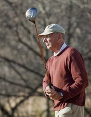 Jerry Waugh, Lawrence, watches the flight of his ball after a drive off the tee at Alvamar on Monday, Nov. 19, 2012.