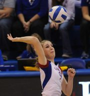 Kansas University's Caroline Jarmoc (9) makes a kill at the net against St.Louis on Wednesday, Nov. 21, 2012, in Allen Fieldhouse.