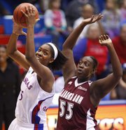 Kansas forward Chelsea Gardner catches a pass in the paint as she is defended by Alabama A&M center Nadra Robertson during the first half, Friday, Nov. 23, 2012 at Allen Fieldhouse.