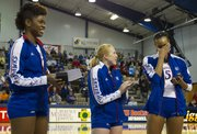Kansas' Tayler Tolefree, right, wipes away tears as Morgan Boub, center, and Sylvia Bullock watch as the three KU seniors are introduced to the crowd following their three-set sweep of Texas Tech on senior day at Horejsi Center Saturday, Nov. 24, 2012.