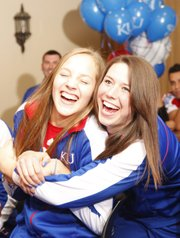 Kansas volleyball player Sara McClinton, left, is hugged by Amy Wehrs as the two watch the NCAA selection show with their teammates on Sunday, Nov. 25, 2012 in the Naismith Room at Allen Fieldhouse.