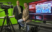 Scott Reinardy, associate professor of journalism, left, and Cal Butcher, director of the new Media Crossroads project, expect the project's TV studio space and equipment to be used by students to create and communicate their unique stories. The space is located on the fourth floor of the Kansas Union.