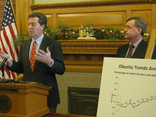Gov. Sam Brownback and KDHE Secretary Robert Moser on Tuesday talk about the Governor's Weight Loss Challenge during a news conference.