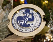 This years Kansas state ornament bears the 150th anniversary logo of Washburn University, depicting the schools mascot, the Ichabod. The back of the ornament bears the state seal. The ornament was unveiled at Cedar Crest in Topeka Nov. 26, 2012. 