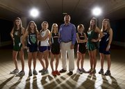 The Journal-World All-Area Girls cross country team, from left: Meredith Wolfe, De Soto; Kate Albrecht, Bishop Seabury; Kaitlyn Barnes, Baldwin; runner of the year Grace Morgan, Lawrence; coach of the year Mike Spielman, Baldwin; Claire Sanner, Lawrence; Bailey Sullivan, Free State; and Amber Akin, Mill Valley.