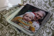 A people flip book helps a toddler recognize family and pets. Photos are labeled, laminated and put on a binder ring.