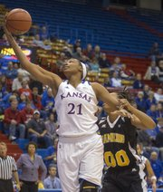 Kansas' Carolyn Davis (21) makes a move past Victoya Ricks (00) during Kansas' game against Grambling State Wednesday, Nov. 28, 2012 in Allen Fieldhouse.