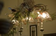 A decorated chandelier is part of the Christmas décor at M Street Interiors, 825 Massachusetts St.