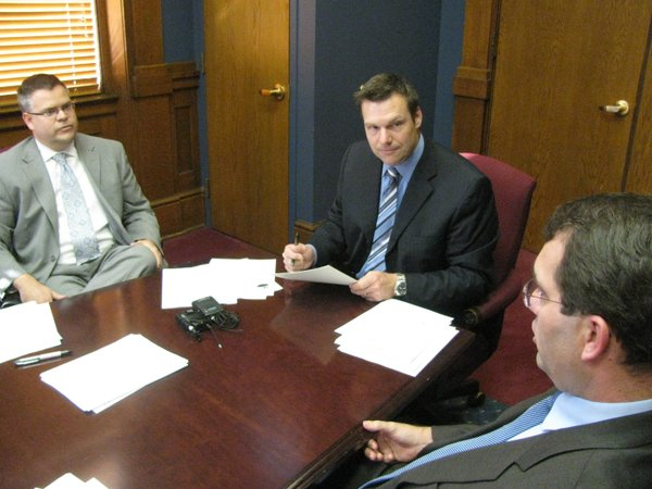 The State Board of Canvassers on Thursday certified the Nov. 6 general election results. From left to right are Gov. Sam Brownback's general counsel Caleb Stegall, Kansas Secretary of State Kris Kobach, and Kansas Attorney General Derek Schmidt.