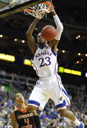 Kansas guard Ben McLemore finishes a dunk over Oregon State guard Challe Barton during the first half on Friday, Nov. 30, 2012 at the Sprint Center in Kansas City, Missouri.