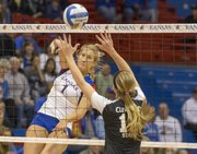 Kansas' Chelsea Albers (1) slams the ball past Kara Koch during Kansas' opening round NCAA tournament volleyball match against Cleveland State Friday, Nov. 30, 2012 at Allen Fieldhouse. The Jayhawks won, 3-1, and advance to face Wichita State tomorrow at 6:30 p.m.