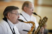 River City Reeds member Clyde Bysom, who is 93, performs along side Charles Kessinger on Nov. 30 for the preschoolers at Kids First Preschool.