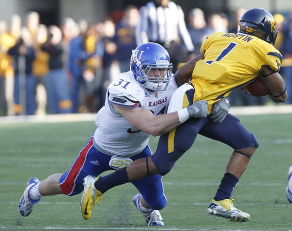 Kansas linebacker Ben Heeney (31) tackles West Virginia's Tavon Austin (1) in KU's game Saturday against West Virginia University in Morgantown, W.Va.