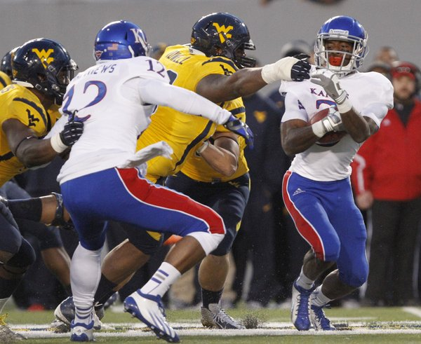 Kanas running back Tony Pierson (3) avoids a tackle by West Virginia defender Shaq Rowell in KU's 59-10 loss Saturday against West Virginia University in Morgantown, W.Va.