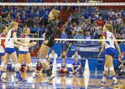 Wichita State's Katie Reilly celebrates a point as Kansas players move to huddle during Kansas' second round NCAA tournament game against Wichita State, Saturday, Dec. 1, 2012 in Allen Fieldhouse. The Jayhawks fell, 3-1, and with the loss their season ended.