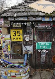 "A backyard shack is decorated with an assortment of signs and junkyard treasures. Nick Schmiedeler&squot;s yard and house, 710 Missouri St., is decorated with many such treasures. Schmiedeler&squot;s home is one of two Lawrence residences scheduled to be featured on upcoming episodes of HGTV&squot;s ""Home Strange Home."""