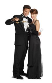 For a black tie occasion, men should wear a tuxedo and women should wear a floor-length gown.